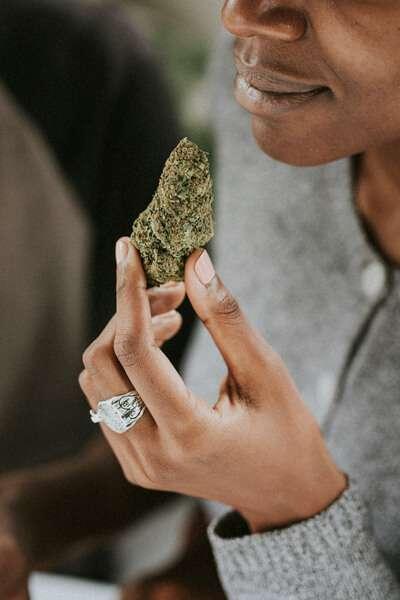 woman holding CBD hemp flower