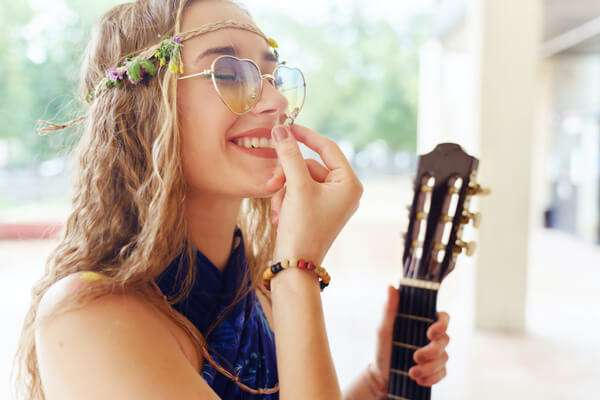 joyous young woman with CBD hemp flower